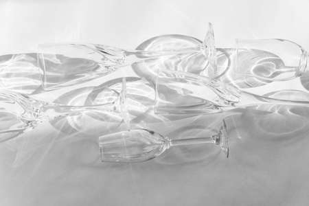 Empty glasses stand on a gray background, top view.Black and white image.