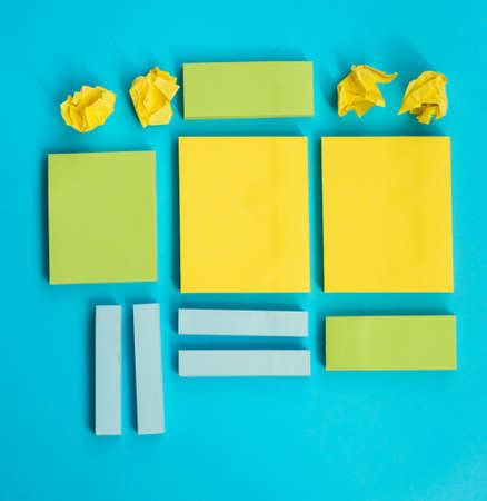 Stickers for entries of different sizes and colors are placed on a blue background.Notebooks for notes and reminders.A flat line.