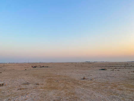 A beautiful view of the sunset near the Al Khor desert area in northern Qatar. Reklamní fotografie