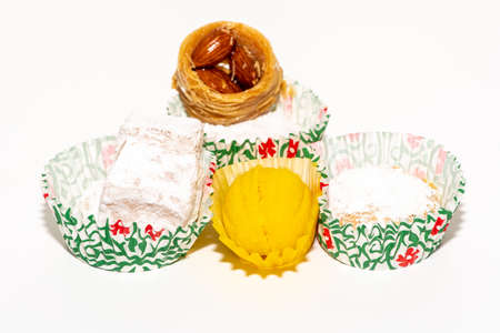 Traditional Christmas cookies with icing sugar isolated on a white background