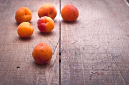 mellow: Mellow orange apricots on rustic wooden table Stock Photo