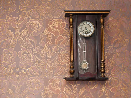 antique wallpaper: Antique clock on the wall with textured wallpaper