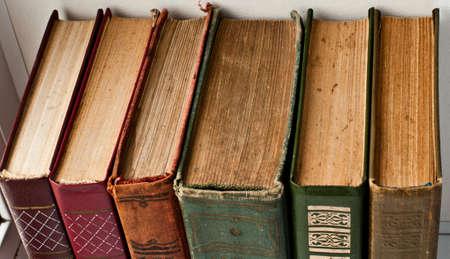 antique books: old vintage antique books pile texture background
