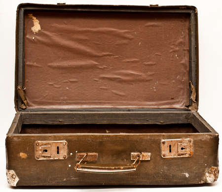 duffel: old shabby brown suitcase with angle bars Stock Photo