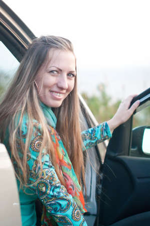 beginner: young woman driver beginner is sitting in the car