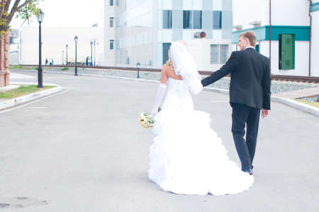 Happy young husband and wife are walking