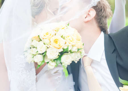 Happy young husband and wife are kissing