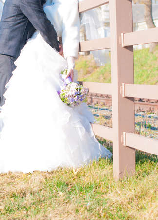 marriageable: Happy Bride And Groom Embracing Outdoors