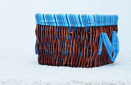 spliced: webbed basket with blue sheeting on te white background