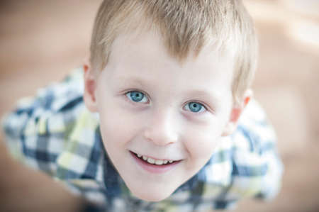crafty: happy cheerful kid is looking at his parent Stock Photo