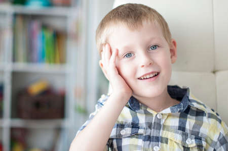 naughty boy: Little cheerful child is dreaming in childrens room Stock Photo