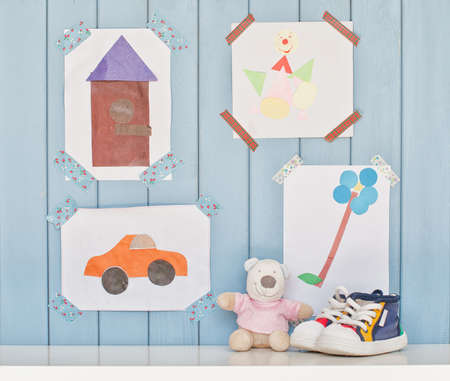clown shoes: Funny colorful child pictures on the wall in the room Stock Photo