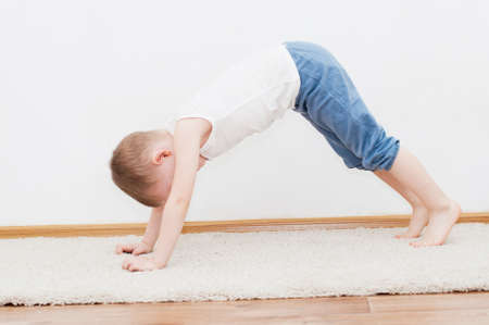 4 years old: 4 years old kid is doing adho mukha shvanasana