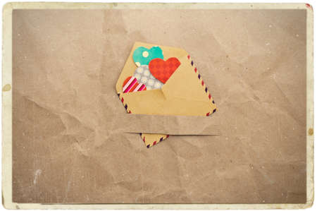 missive: envelope with hearts on old vintage crumpled paper background