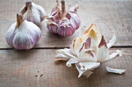 fragrant: Fresh fragrant garlic bulbs on kitchen wooden table