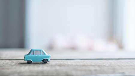 Toy model of retro car in nursery room