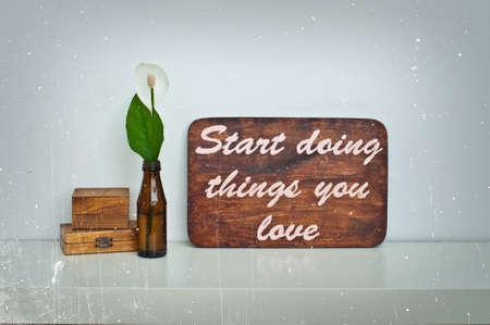 love letter: Motivating grunge wooden poster quote Start doingthings you love Foto de archivo