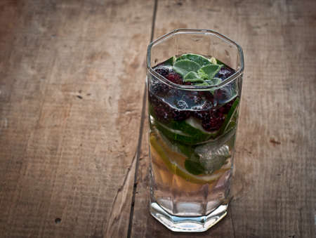 sassy: Fresh cold lemonade, fruit sassy water with lemon, cucumber, peppermint and blackberries on wooden background
