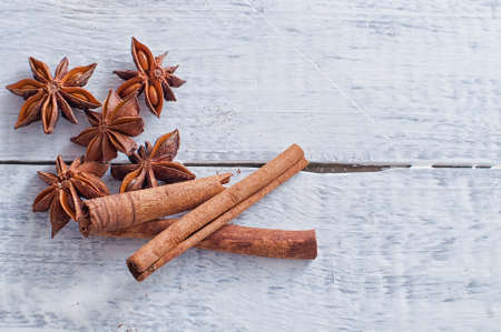 christmas perfume: cinnamon stick and star anise spice on wooden background