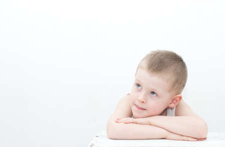 4 years old: pensive 4 years old boy on white background