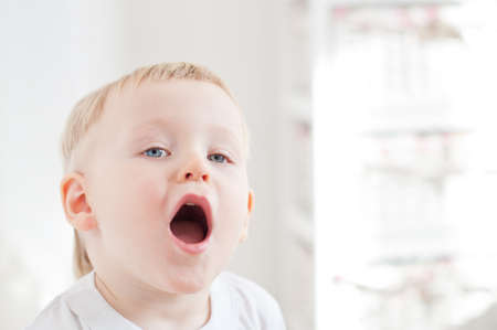 opened: little cute boy is singing with opened mouth Stock Photo