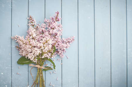 hanging flowers: Summer gentle bouquet of lilac flowers on the old blue wooden background Stock Photo