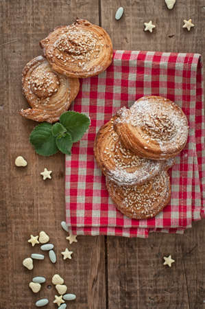 gingham: Homemade bakery, puff cookies with sesame seeds and sugar candies on gingham table cloth Stock Photo