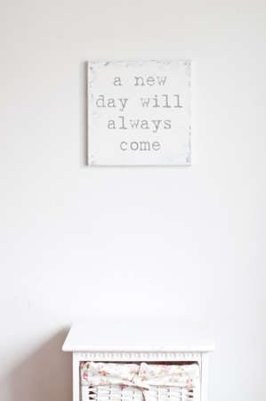 white canvas: Old shabby canvas on the white wall in the room