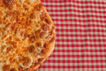 gingham: Pizza with crispy crust on gingham table cloth, cheese, margarita Stock Photo