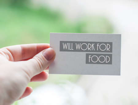 cutback: Visit card of unemployed designer with inscription Will work for food