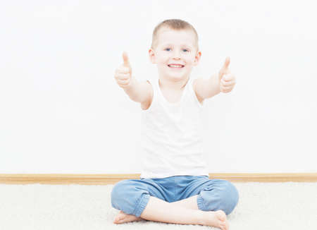 4 year old: Portrait of cheerful boy showing thumbs up