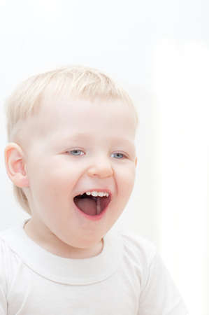 teethy: happy little boy  on the white background