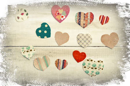 missive: Colorful hearts on shabby vintage wooden background