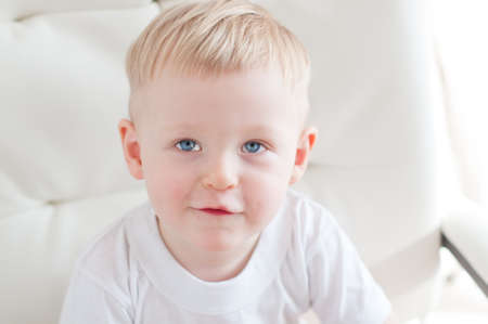looking up: little cute blue-eyed  boy is looking up Stock Photo