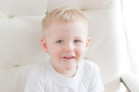 looking up: little cute blue-eyed  boy is looking up and smiling Stock Photo