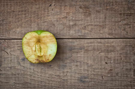 sear: Old dry sear green apple on rustic vintage wooden table