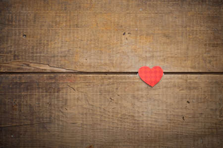 missive: red heart on grunge wooden background