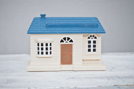toy house: Toy house with blue roof and brown door