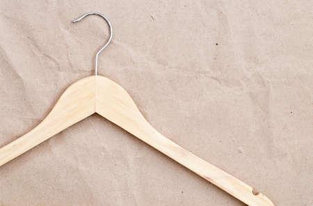 paper hanger: Wooden hanger on craft paper background Stock Photo