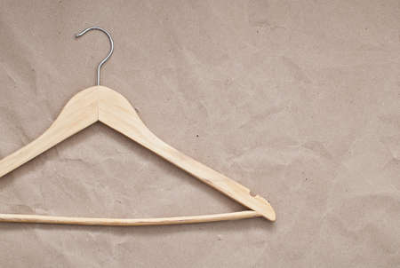 paper hanger: Wooden hanger on craft paper background Stock Photo