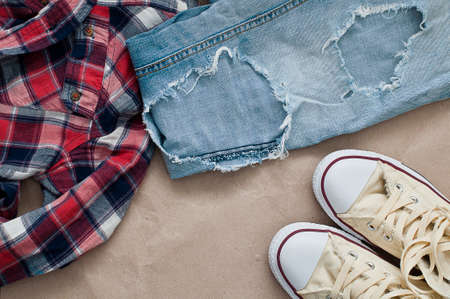 checked shirt: Crumpled red blue checked shirt, jeans  and shoes Stock Photo