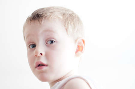 puzzlement: little 4 years old surprised  boy
