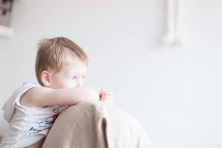 by feel: little 4 years old boy is feel sad Stock Photo