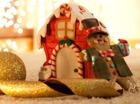 night before christmas: christmas eve with gingerbread man and house and golden defocused lights