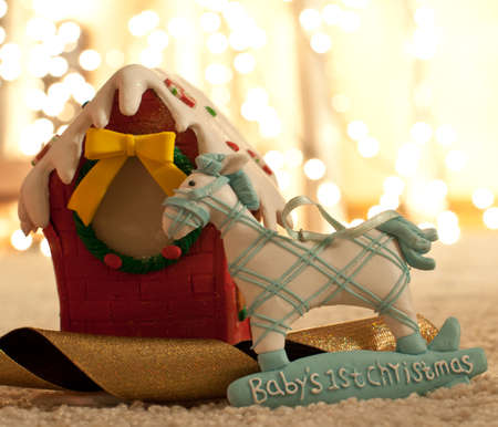 night before christmas: babys first christmas eve; gingerbread house, bokeh
