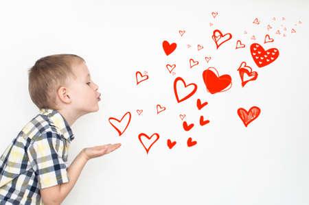 flying kiss: Little kid is sending heart shaped kisses