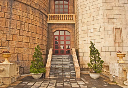 decorative balcony: balcony in the medieval castle, stairs, ledge and decorative trees