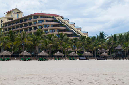 Hotel, palms and white sand in the My Khe beach, Danang, Vietnam Editorial