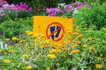 No walking on flowers warning sign in the garden