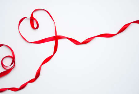 Happy Valentines Day. Red Ribbon Heart on white background. Valentines Day concept 스톡 콘텐츠